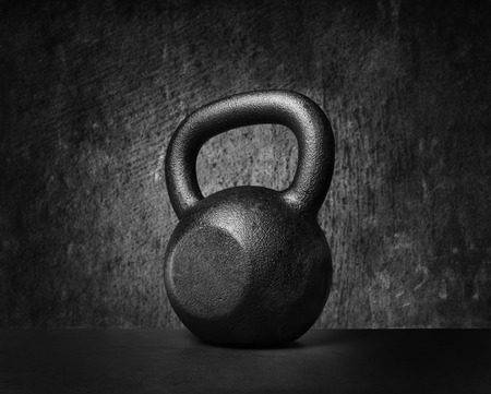Photo for Black and whit image of a rough and tough heavy 30 kg 66 lbs cast iron kettlebell. - Royalty Free Image