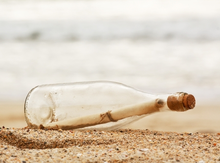 Photo pour a Message in a bottle washed up on the beach, great business concept for snail mail, spam, or bad slow communication - image libre de droit