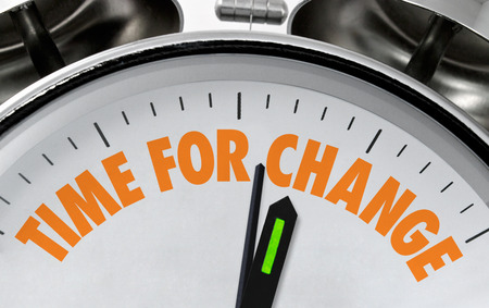 Photo pour Time for Change business proverb or message on a traditional silver chrome clock face - image libre de droit
