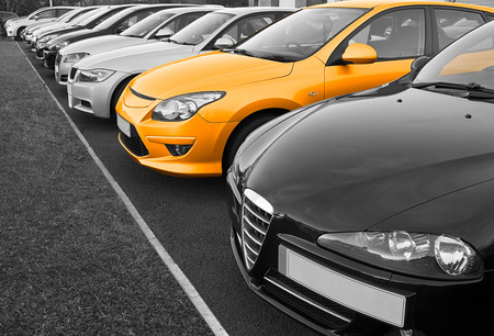 Photo pour The perfect new car of your choice selected from a row of different european marques of used cars for retail sale on a motor dealers forecourt - image libre de droit