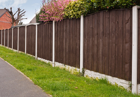 Foto de Close board fence erected around a garden for privacy with wooden fencing panels, concrete posts and kickboards for added durability. - Imagen libre de derechos