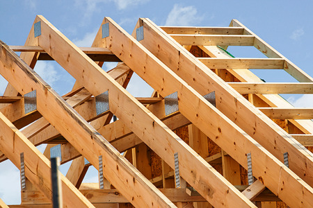 Photo pour Standard timber framed building with close up on the roof trusses - image libre de droit