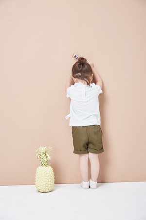 Photo for The little girl's back, round head, a thin braid in her hair. - Royalty Free Image