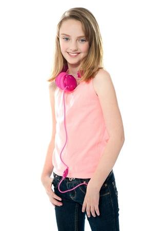 Stylish trendy girl with headphones around her neck
