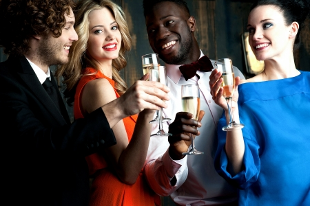 Photo for Carefree young couples having cocktails and partying - Royalty Free Image