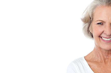 Foto de Smiling joyous old lady, cropped image. - Imagen libre de derechos