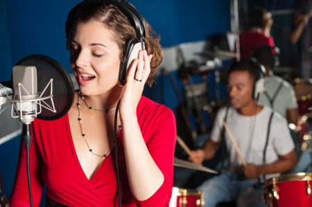 Photo for Female playback singer recording a track - Royalty Free Image