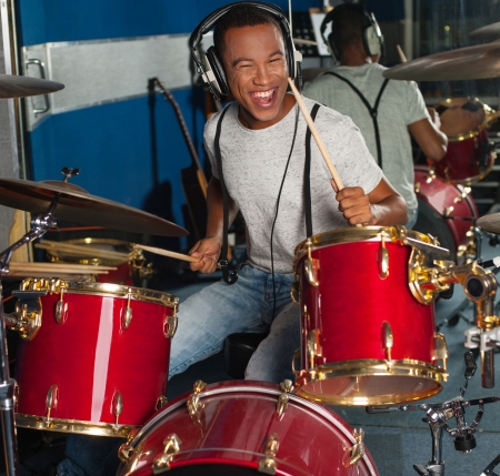 Photo for Drummer in action inside recording studio - Royalty Free Image