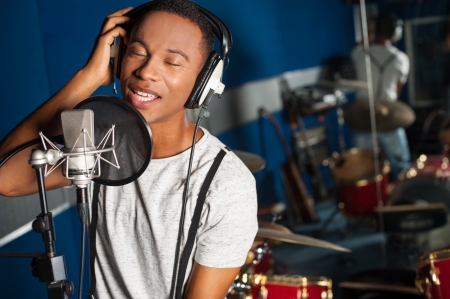 Photo for Young male singer in recording studio - Royalty Free Image