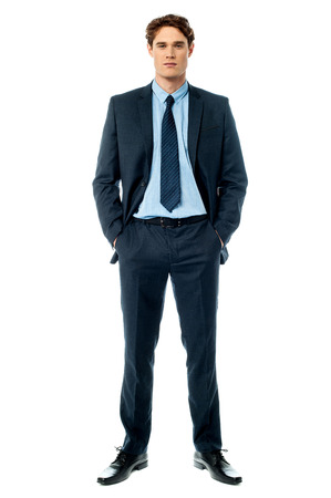 Photo for Businessman posing with hands in pocket isolated on white  - Royalty Free Image