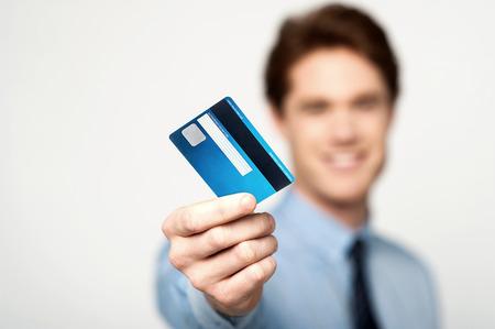 Photo pour Young corporate guy showing his debit card - image libre de droit