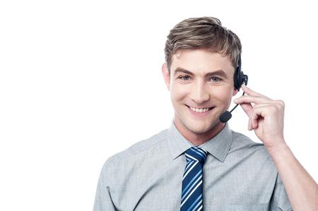 Foto de Happy young male customer support executive - Imagen libre de derechos