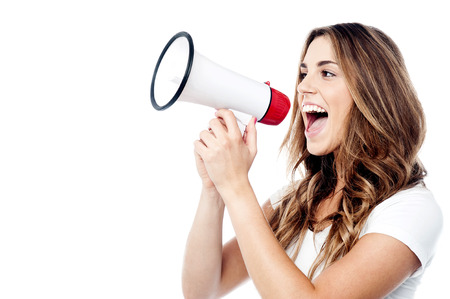 Photo for Woman making announcement with megaphone - Royalty Free Image