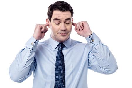 Photo pour Businessman plugging ears with fingers - image libre de droit