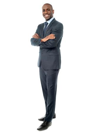 Photo pour Corporate guy posing with arms crossed - image libre de droit