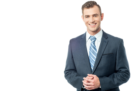 Photo for Handsome young executive with clasped hands - Royalty Free Image