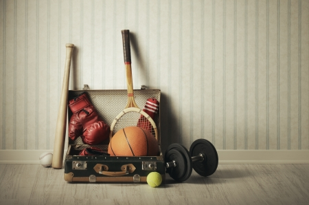 Old Suitcase with sports equipment