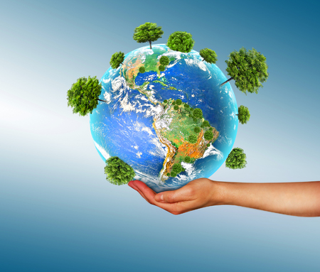 Photo for Ecological concept of the environment with the cultivation of trees on the ground in the hands. Planet Earth. Physical globe of the earth. - Royalty Free Image