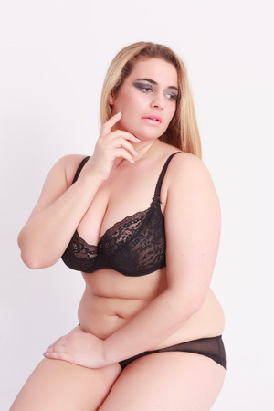 Photo pour Sensual Young blond woman with oversize in lingerie, sitting in front of white background - image libre de droit