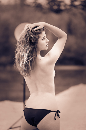 The 19-year-old blonde stands sideways with the back topless to the camera, she does not tell too much