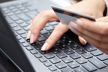 Foto de woman holding credit card on laptop for online shopping concep - Imagen libre de derechos