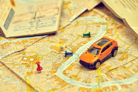 Photo pour Travel concept - small toy car on the map - image libre de droit