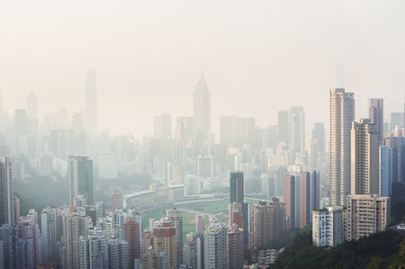 Photo for Air pollution hangs over the Happy Valley district of Hong Kong Island - Royalty Free Image