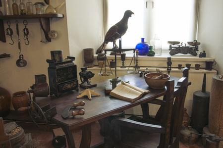 Foto de Grodno, Belarus - Jule 12, 2017: Interior of the old pharmacy in Grodno. Apothecary table with vintage appliances. - Imagen libre de derechos