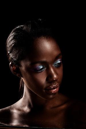 Foto de Glamorous African Beauty, beautiful African woman with blue eyeshadow on dark background. - Imagen libre de derechos