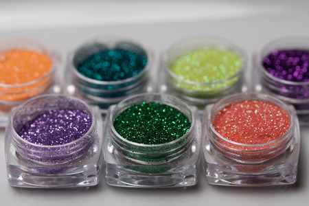 Photo for Closeup set of colorful nail makeup glitter in round jar isolated on white background. Concept of beauty and makeup - Royalty Free Image