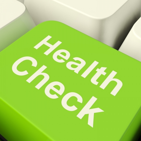 Photo for Health Check Computer Key In Green Showing Medical Examinations - Royalty Free Image