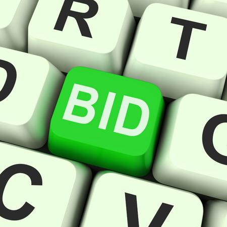 Foto de Bid Key Showing Online Auction Or Bidding  - Imagen libre de derechos