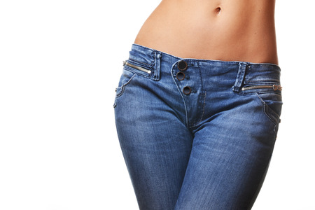Photo pour close-up shot of female wearing jeans, isolated on white background  - image libre de droit