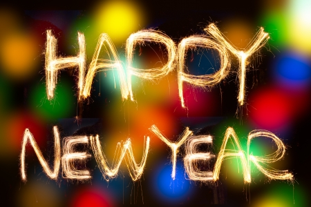 happy new year written with Sparkling figures on bokeh background