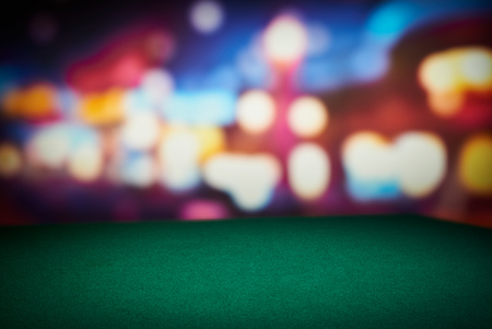 Foto de Poker green table in casino with blur background - Imagen libre de derechos