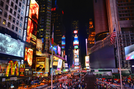 Photo pour NEW YORK CITY, USA - OCTOBER 17, 2014: People on Times Square at night. Times Square is one of the world's most visited tourist attractions. - image libre de droit