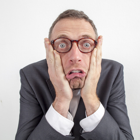 Photo for expressive corporate man concept - shocked middle age businessman expressing surprise and disappointment with humor,wide angle on white background - Royalty Free Image