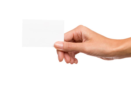 Photo for Close up of woman's hand holding blank white card. Studio shot isolated on white. - Royalty Free Image