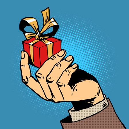 Ilustración de gift in his hand a small box pop art comics retro style Halftone - Imagen libre de derechos