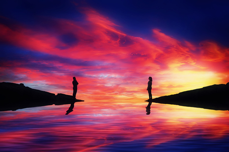 Foto de A boy and a girl stand on different sides of a river think how to reach each other over a beautiful sunset background. Building an imaginary bridge. Life journey and search concept. - Imagen libre de derechos