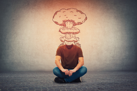 Foto für Surreal guy, invisible face seated on the floor has head explosion. Mental state of human with lot of problems. Angry person with a nuclear mushroom burst instead face, healthcare concept. - Lizenzfreies Bild