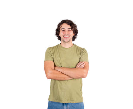Photo pour Portrait of smiling brunette young man, long curly hair style, keeps arms folded looking confident to camera isolated on white background. Cheerful and successful caucasian guy, casual lifestyle. - image libre de droit