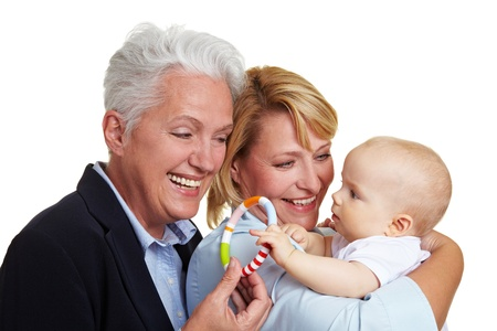 Happy grandmother offering baby a teether