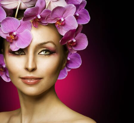 Beautiful Spring Girl With Orchid flowers over black