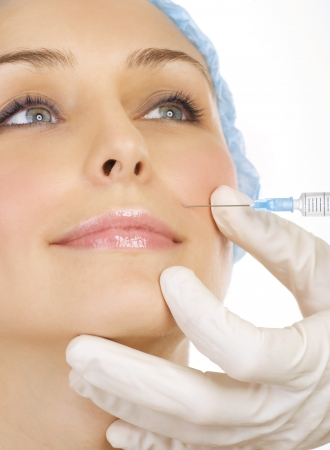 Photo for Woman gets cosmetic injection of botox. Beauty Treatment - Royalty Free Image