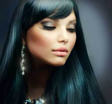Beautiful Brunette Girl Healthy Long Hair and Holiday Makeup