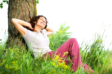 Foto de Beautiful Young Woman Relaxing outdoors  Nature  - Imagen libre de derechos