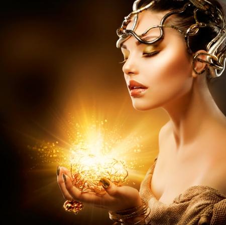 Photo pour Fashion Girl Portrait  Golden Makeup  - image libre de droit