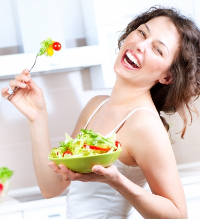 Foto de Diet  Healthy Young Woman Eating Vegetable Salad - Imagen libre de derechos
