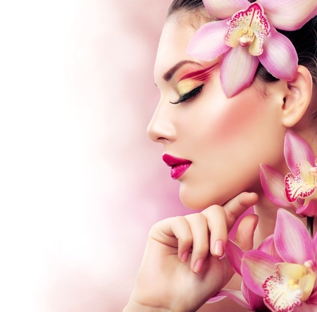 Beautiful Girl With Orchid Flowers  Perfect Make-up
